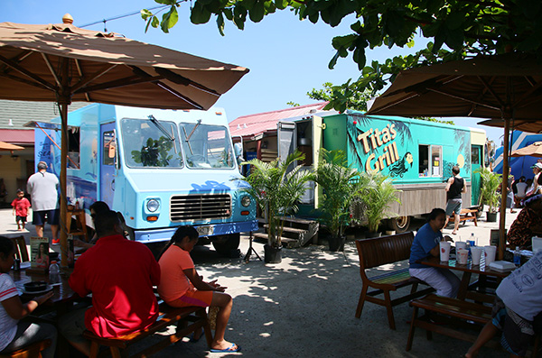 picture of Sam Choy's Seafood & Poke truck and Tita's Grill