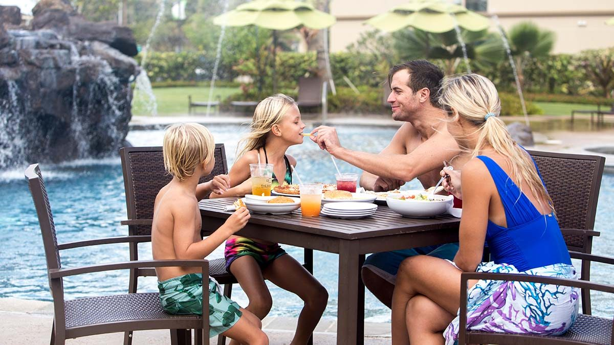 family eating by the pool at Courtyard by Marriott in Laie Oahu Hawaii