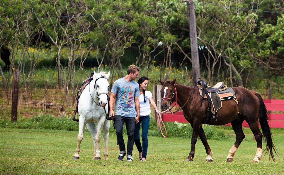 photo of couple with horses from Gunstock Ranch