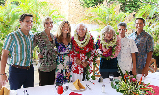photo of David and Carolyn Hannemann and family members celebrate his retirement from the Polynesian Cultural Center