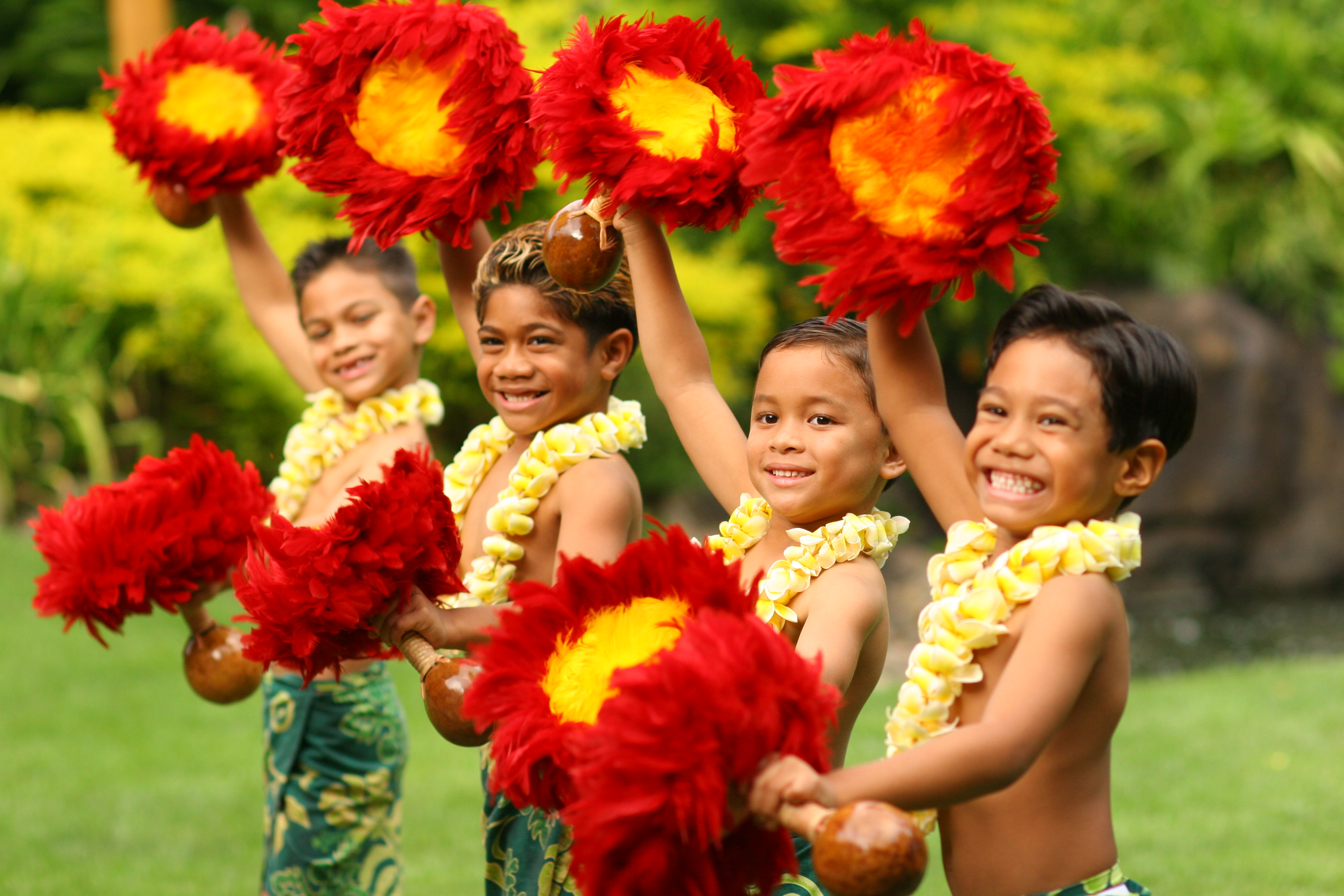 photo of four keiki boys dancing