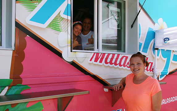 Pictured are Aubrey Warner (right) and her friendly staff from Penny's Malasadas newest food truck at the Polynesian Cultural Center's Hukilau Marketplacein Laie, Hawaii.