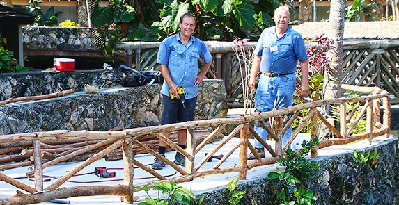 Photo of Elder Green and Nelson assisting with facility improvements at the Polynesian Cultural Center. Photo by Mike Foley