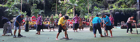 Audience members participate in We Are Samoa coconut husking
