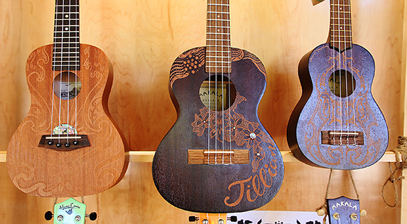 Hand-etched ukuleles in the PCC Kauhola Art Gallery
