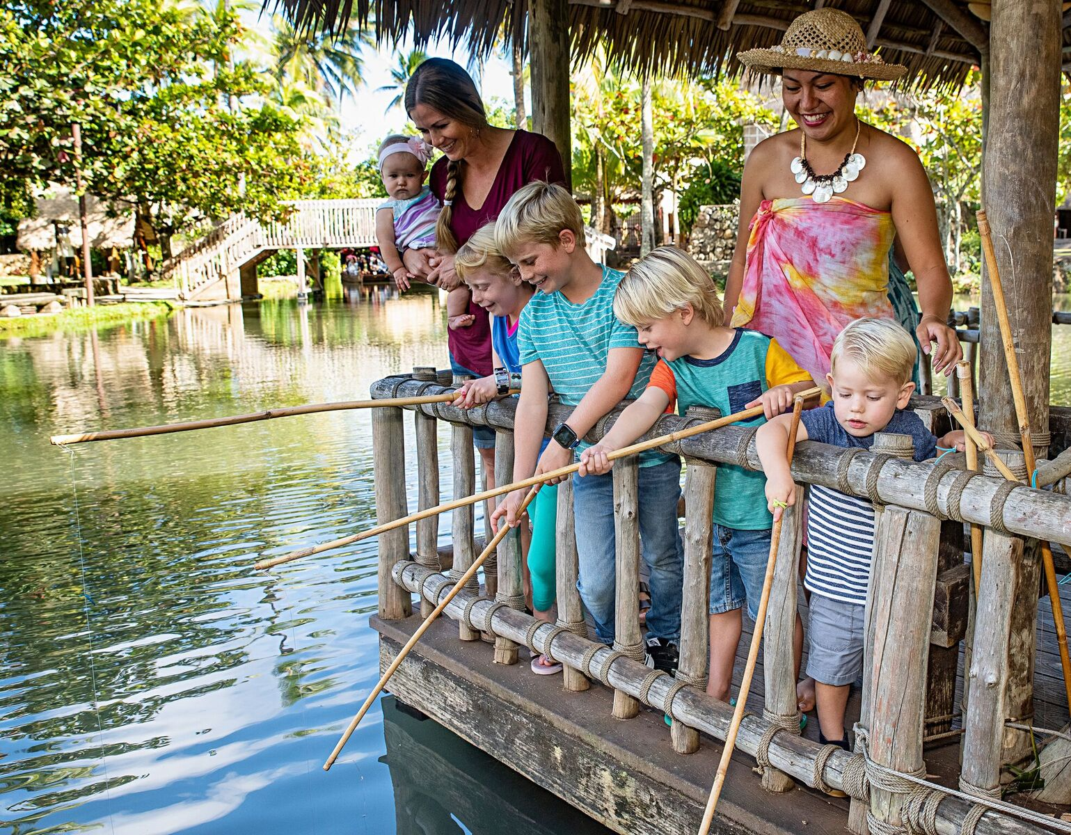Picture of family fishing at Tahiti Village at the Polynesian Cultural Center