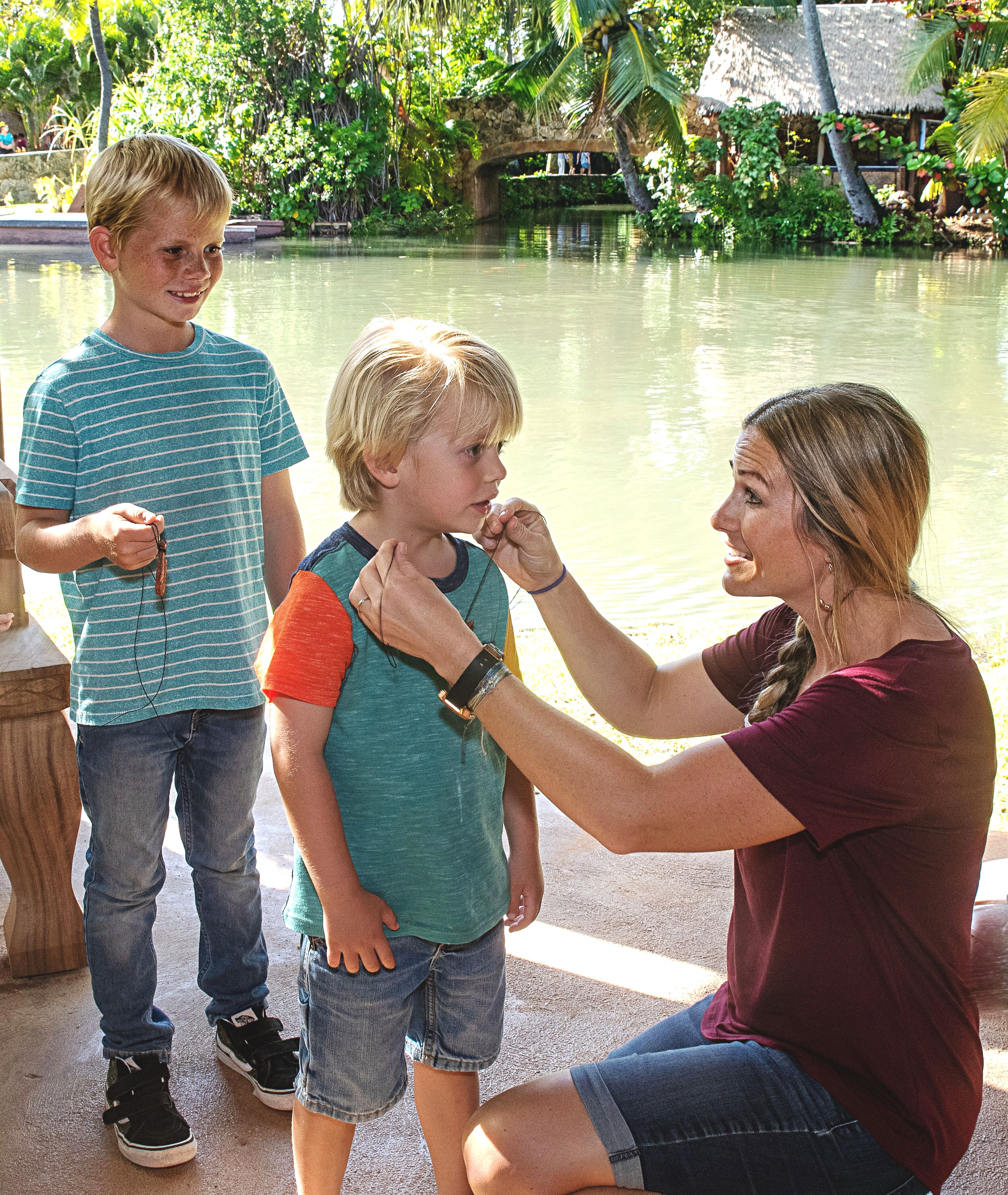 Photo of family with huki necklace at the Polynesian Cultural Center