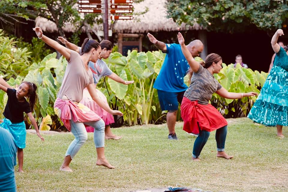 photo of PCC staff and community workes learning the Hula Pahu, a traditional hula used to strengthen the morale of native Hawaiians