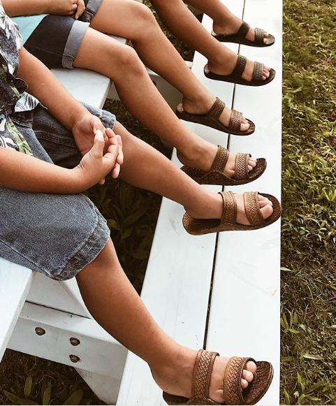 Children wearing J-slips, one of the most popular styles of local Hawaiian footwear.