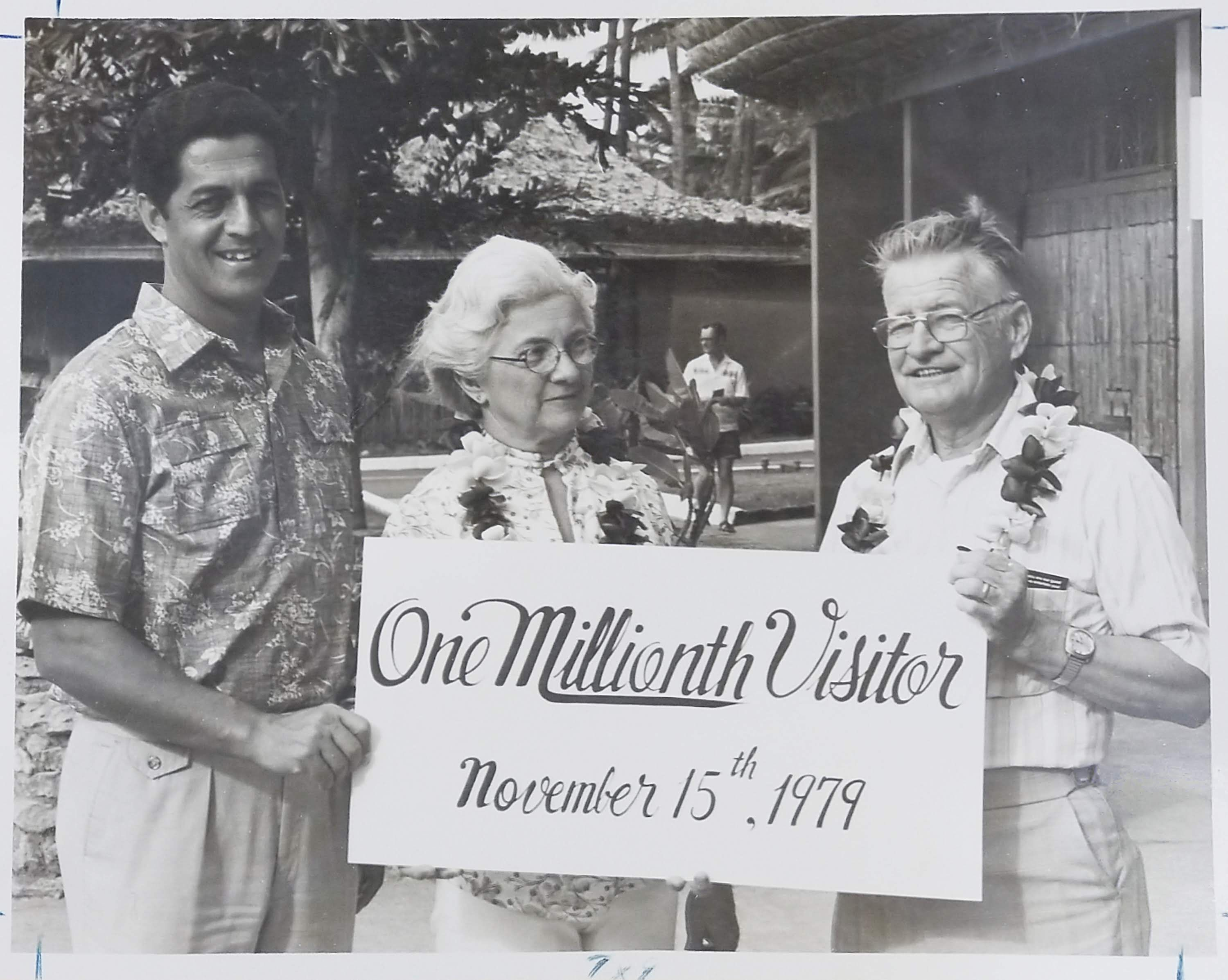 photo of Bill Craven , as President and General Manager of the Polynesian Cultural Center recognizing the one millionth guest at the Center.
