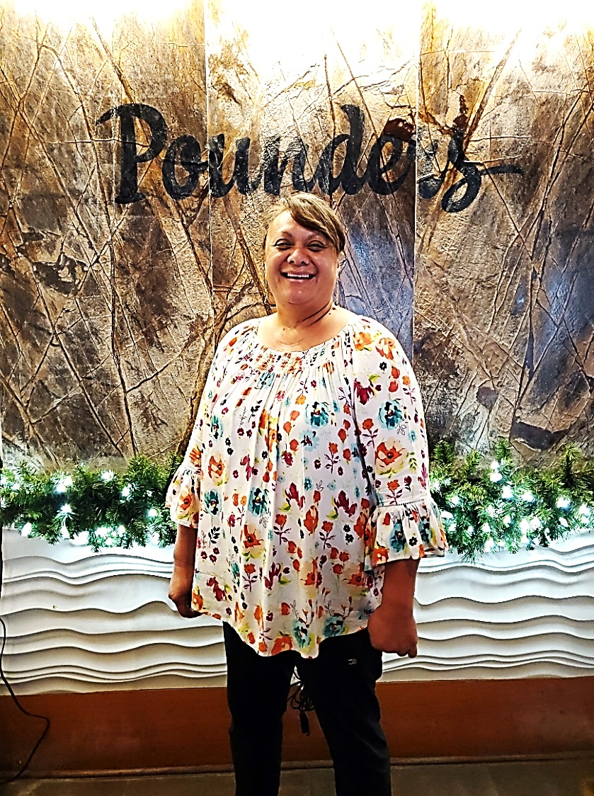 Photo of Dede Alo, general manager of Pounders Restaurant
