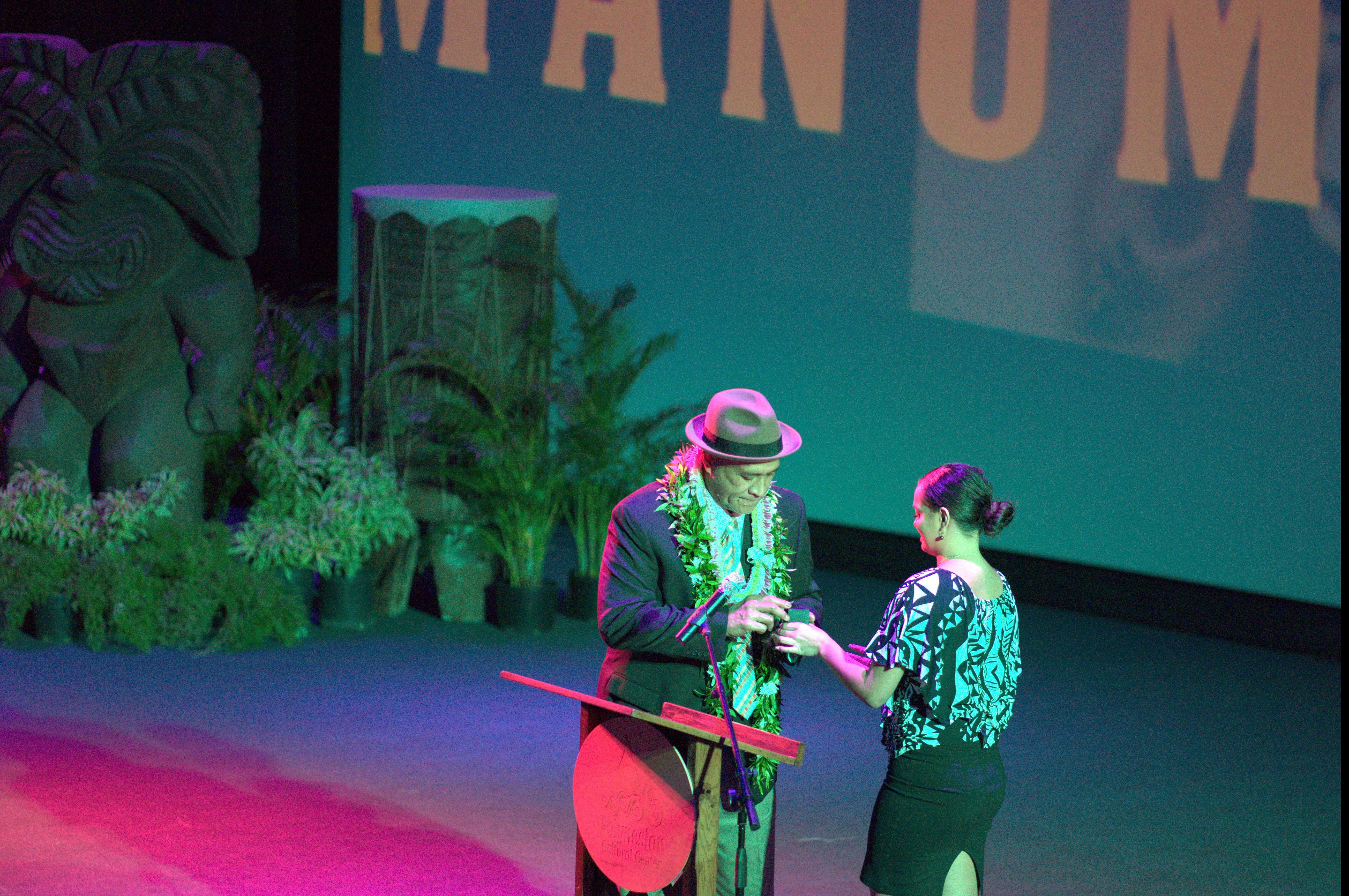 Photo of Frank Manumaluega receiving his induction ring from the Polynesian Football Hall of Fame