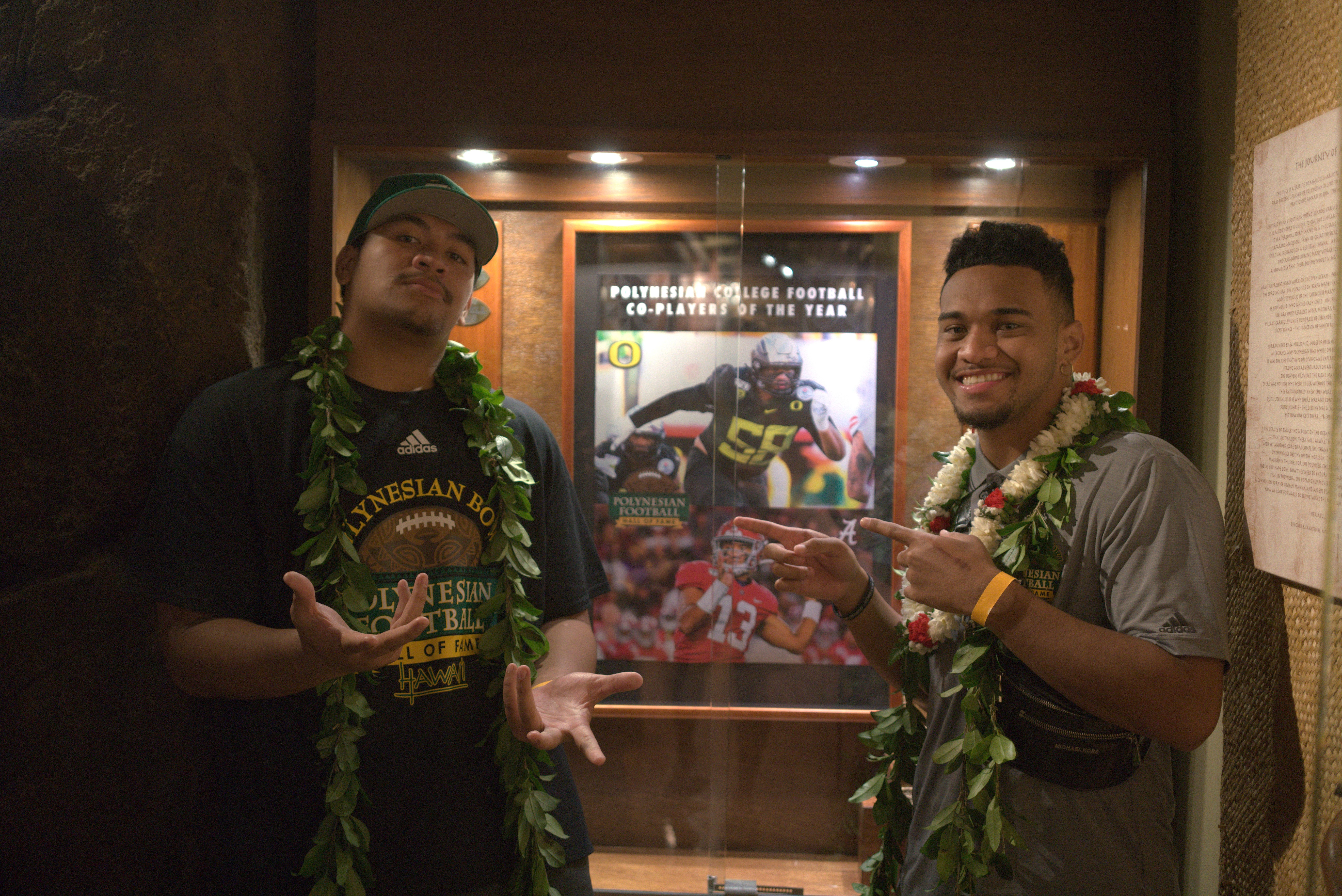 Photo of Peni Sewell (l) and Tua Tagovailoa (r), co-recipients of the 2019 Polynesian Football Hall of Fame College Players of the Year.