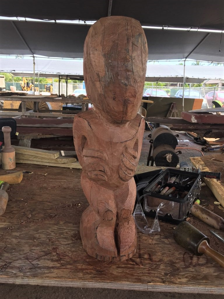 ohia wood carving in progress to become a Teko-Teko tiki in the Maori Village at the Polynesian Cultural Center