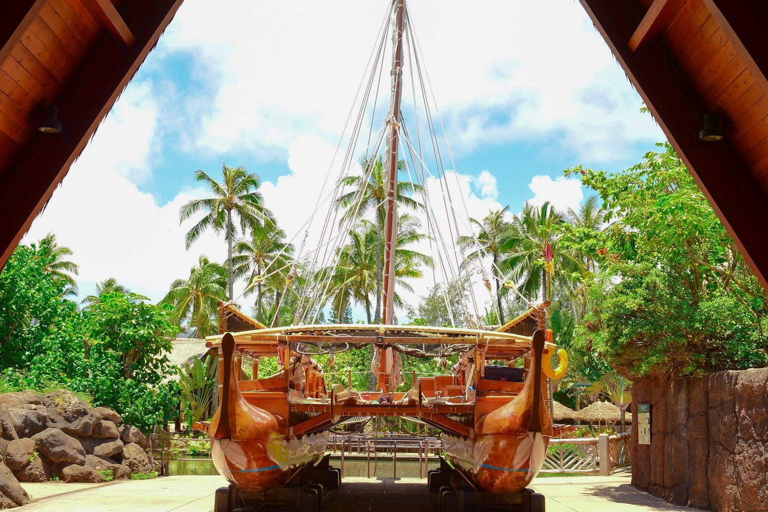 photo of the Iosepa, a doubled hulled sailing vessel used for teaching ancient Polynesian navigational skills. When it is dry-docked, it is housed on the Polynesian Cultural Center's campus
