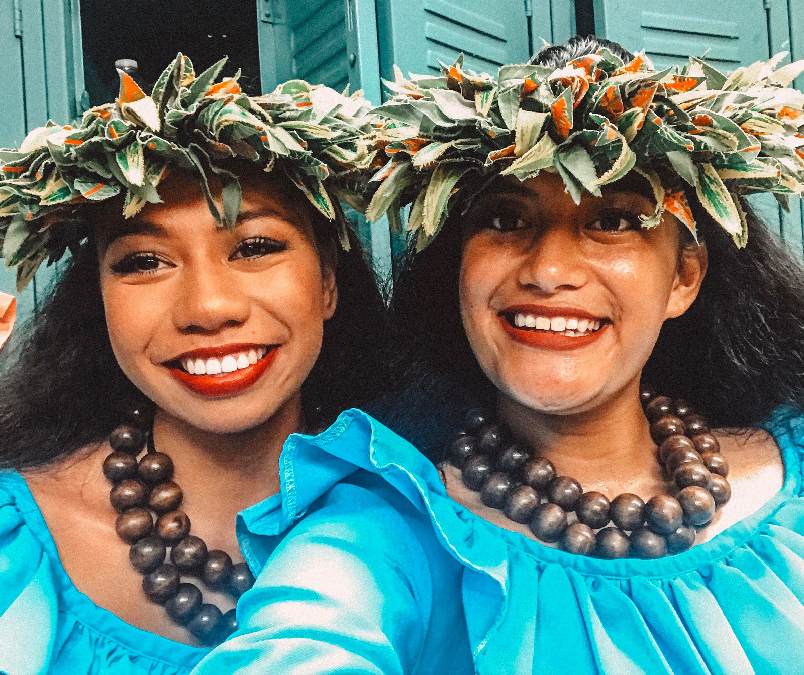 Two women preparing to dance at the Polynesian Cultural Center