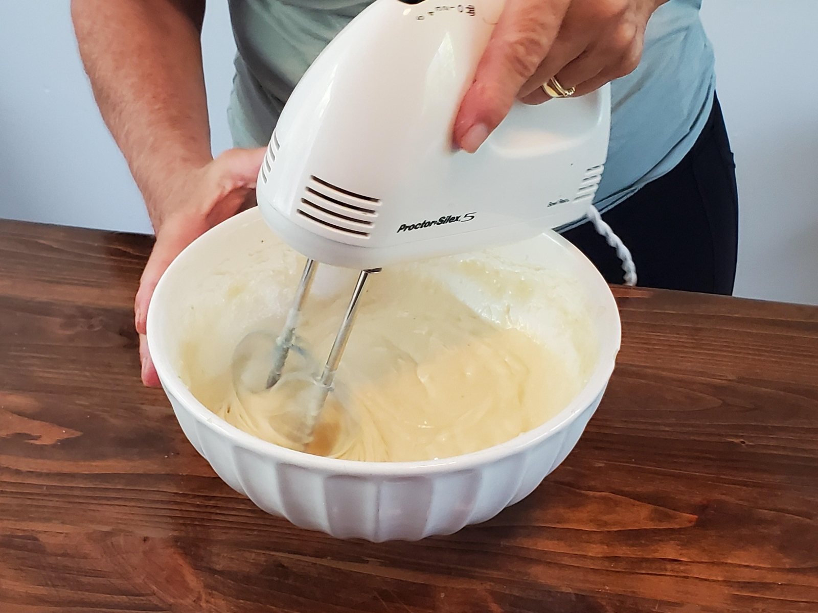 mixer in bowl with tropical banana bread ingredients