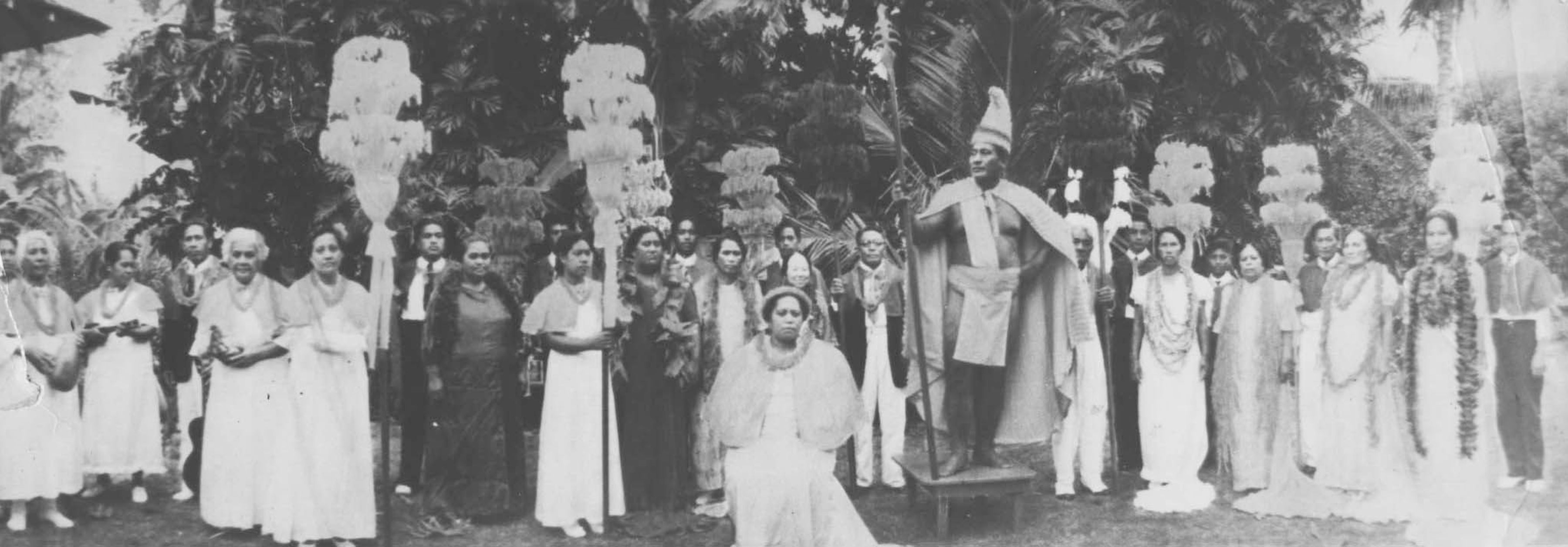 photograph of Hamana Kalili and locals from Laie portraying the royal court of King Kamehameha, with Kalili serving as the king.