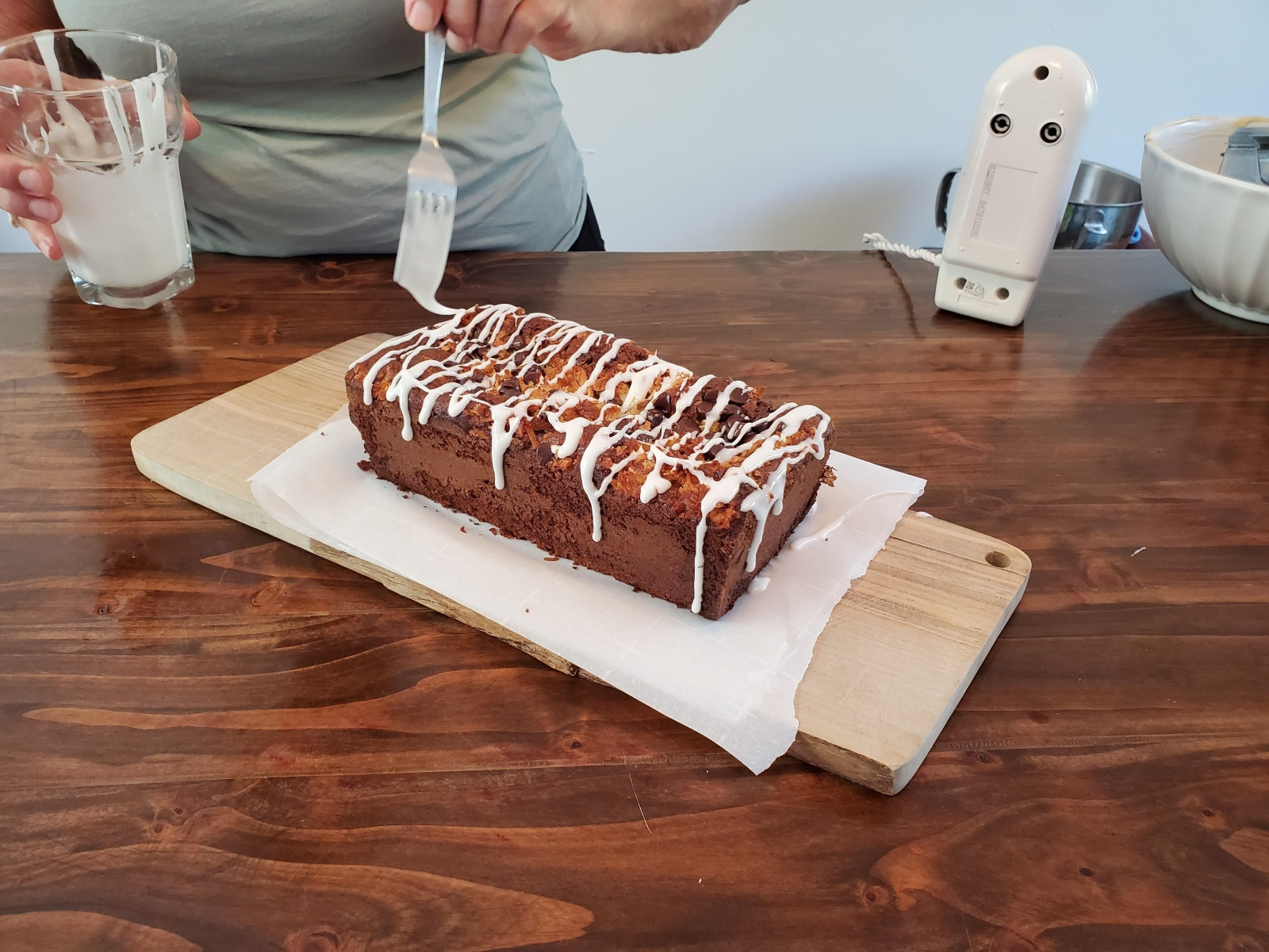Image of cooked Tropical Banana Bread being topped with glaze