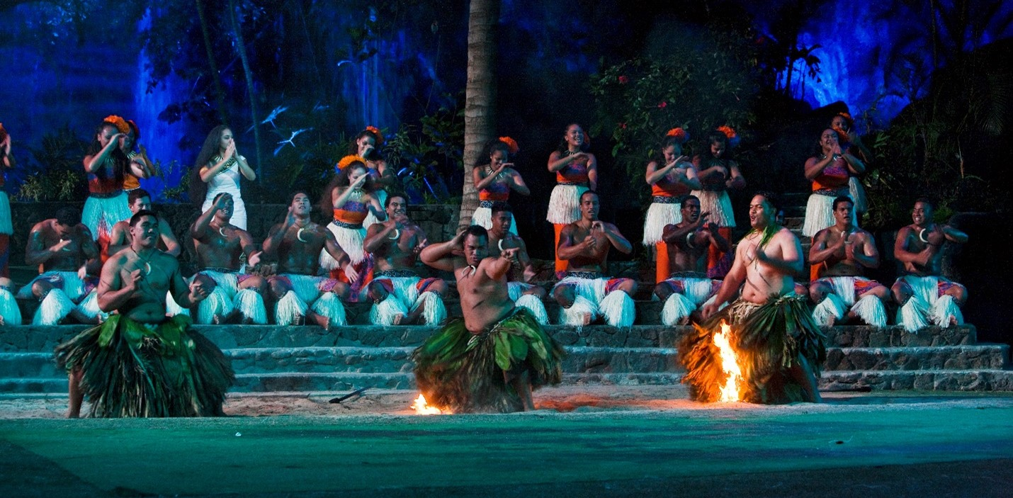 image of firewalkers performing at HA: Breath of Life at the Polynesian Cultural Center. The Center plans to fully reopen in March, 2021.