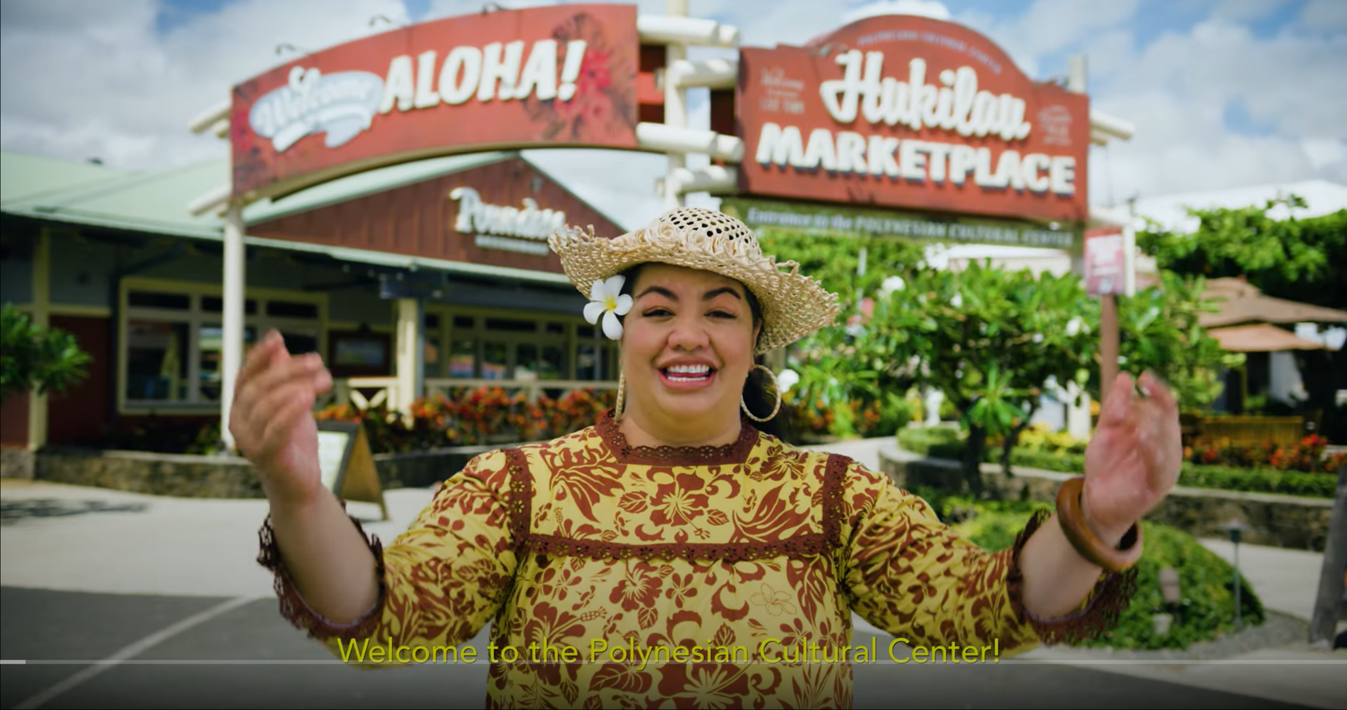 Telesia Tonga welcoming guests to the Polynesian Cultural Center and Hukilau Marketplace