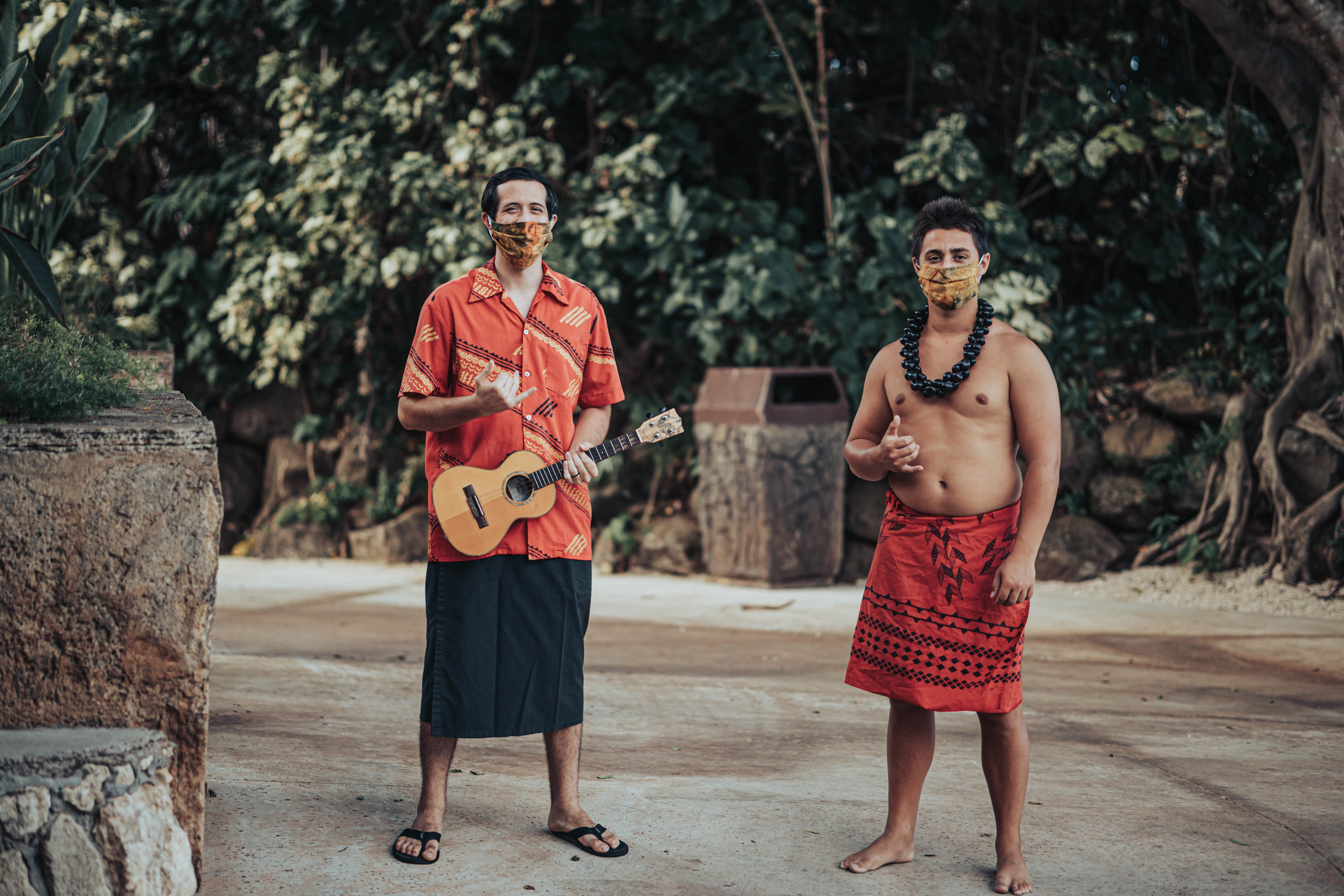 photograph of two island villagers at the Polynesian Cultural Center ukulele shaka northshore oahu hawaii