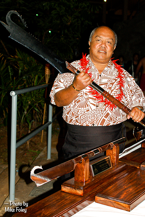 Photo of Pulefano Galeai displaying the one of the ailao afi prizes for the World Fireknife Championships