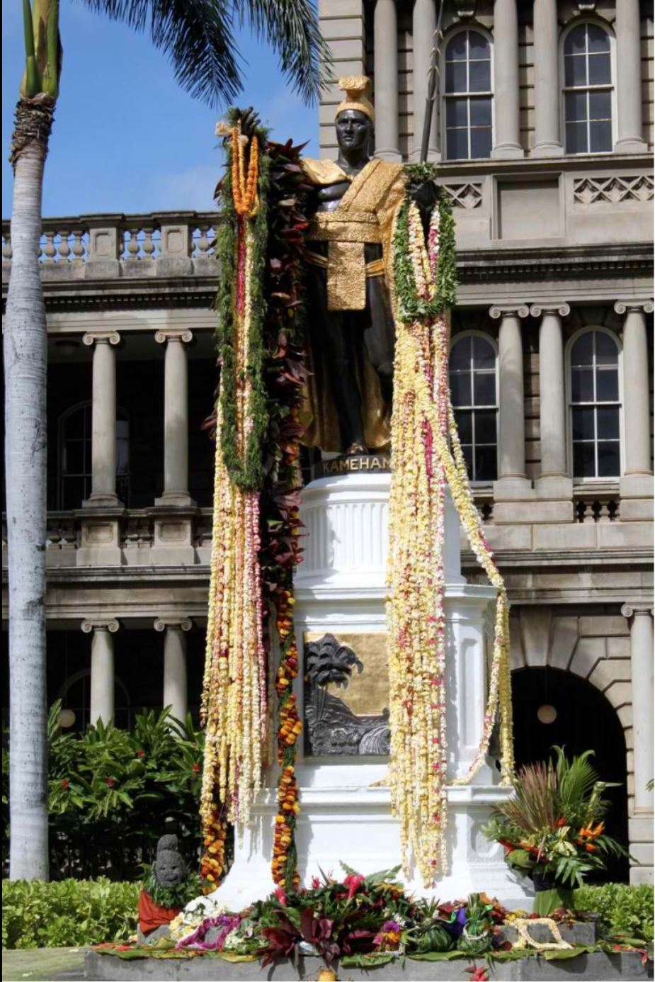 A statue of King Kamehameha I in front of the legislative buildings of Hawaii is draped in flowers every June 11 in commemoration of Kamehameha Day