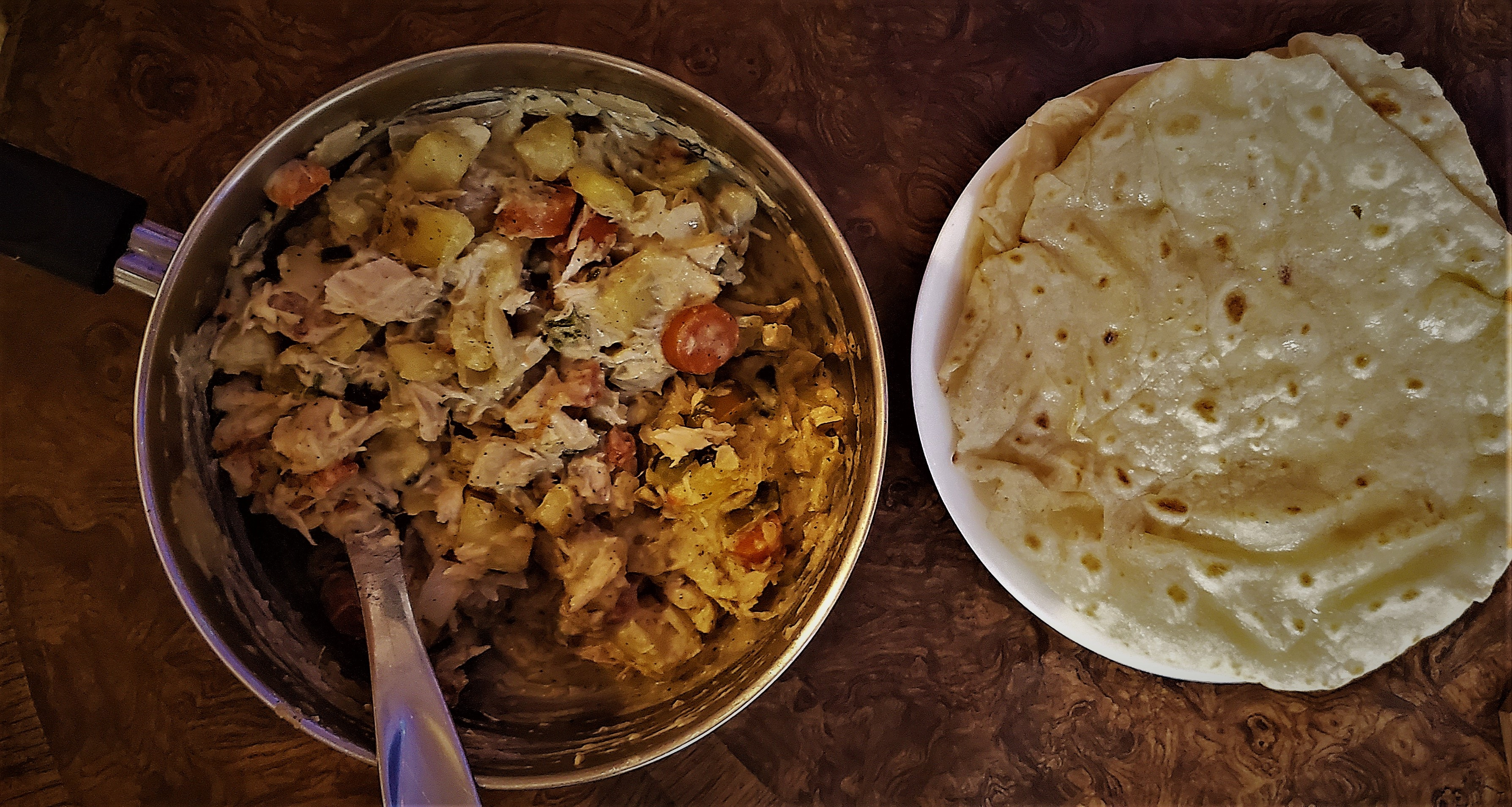 Photograph of chicken curry and prepared roti