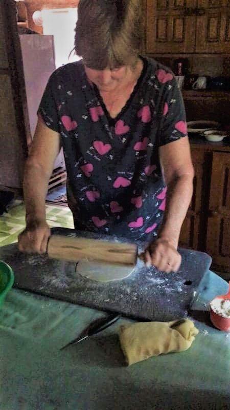 photo of woman making roti, an Indian flat bread popular in Fiji