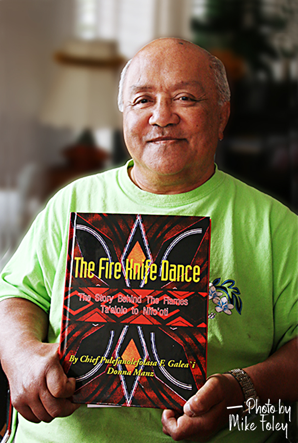 image of Pulefano Galeai holding his book The Fire Knife Dance: The Story Behind the Flames Ta'aoo to Nifo'oti