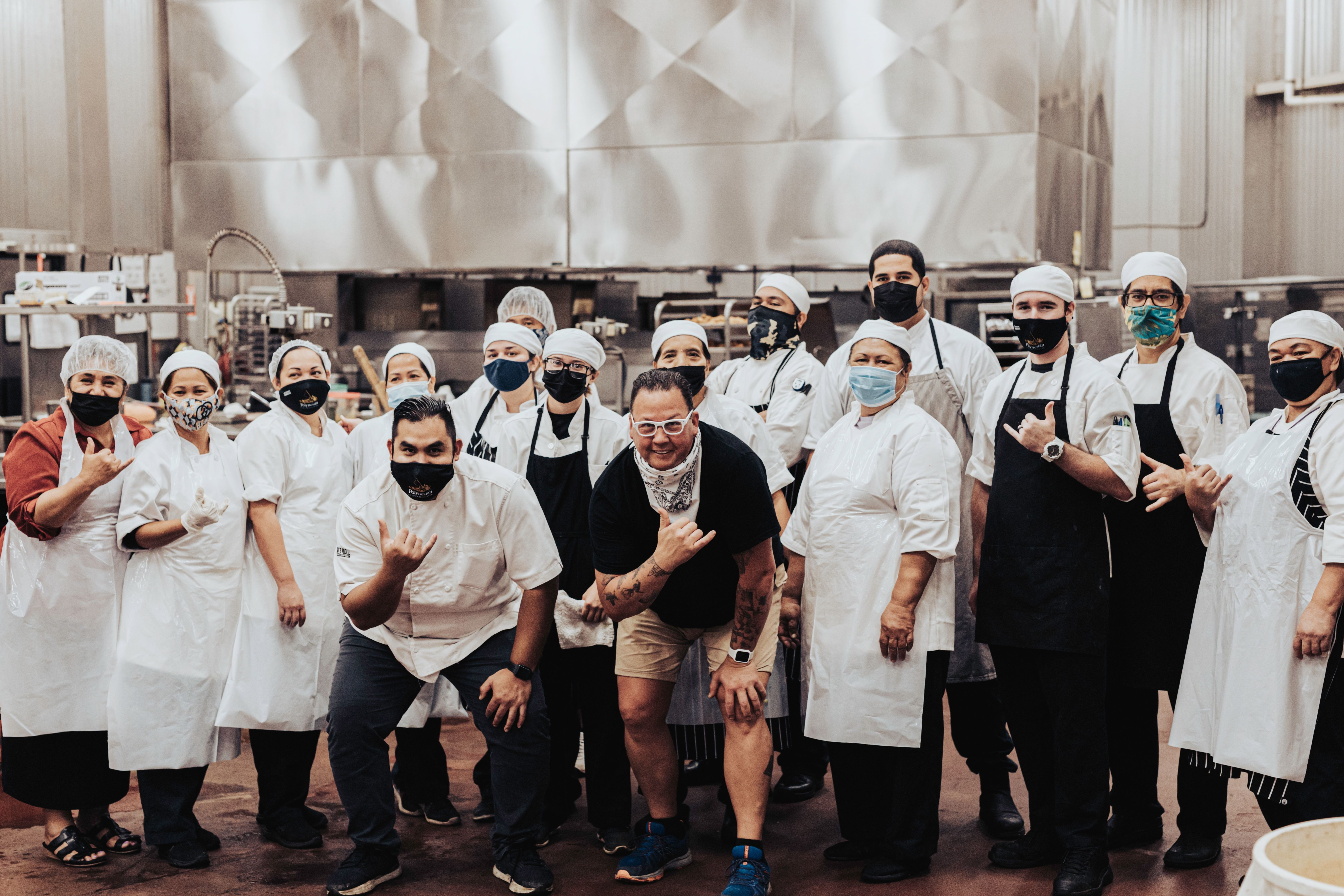 image of food services staff at the Polynesian Cultural Center pose for a 'masked' photo with Chef Graham Elliot