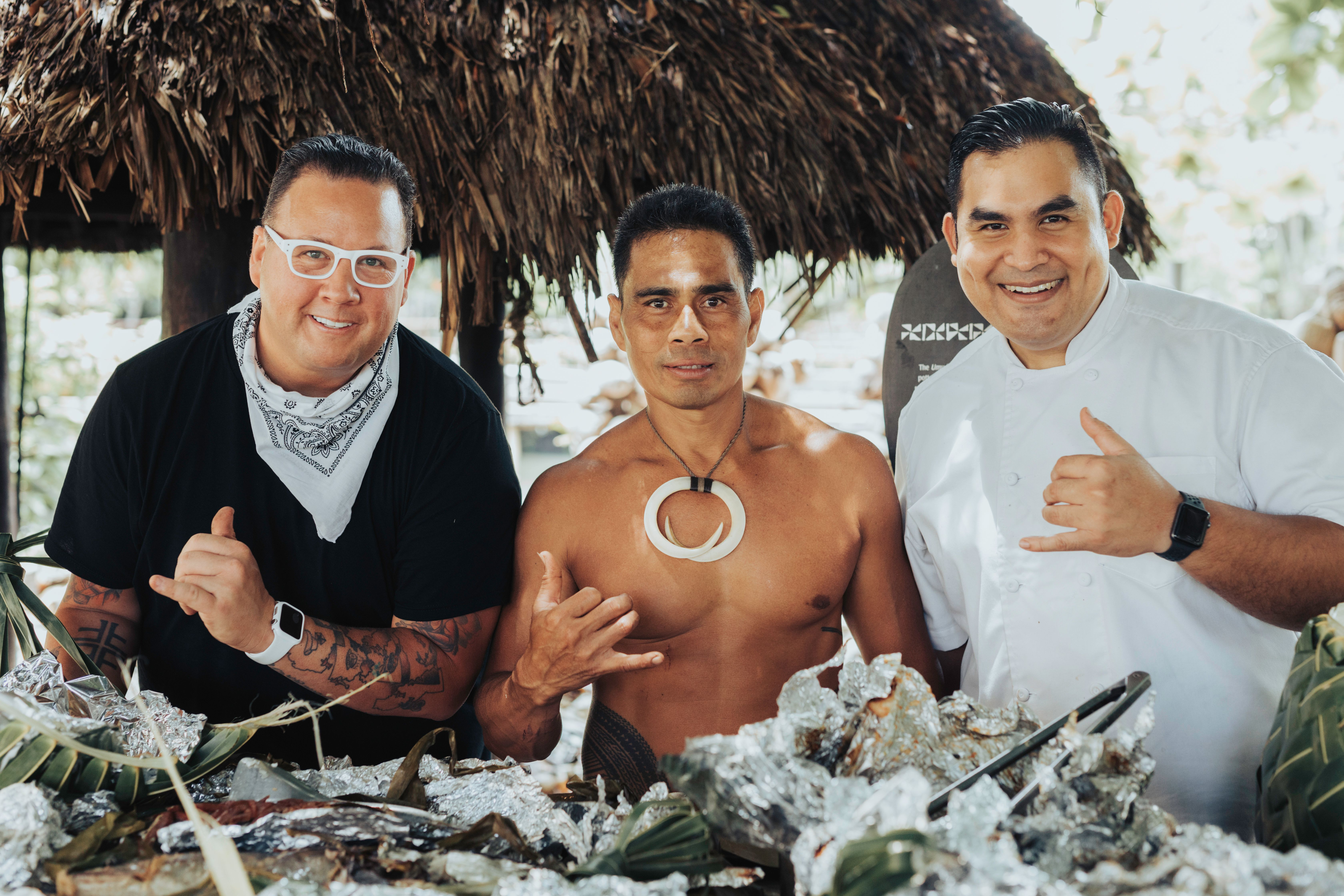 photo of three men at a Samoan cookout at the Islands of Polynesia in the Polynesian Cultural Center