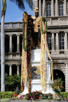 Statue of King Kamehameha covered in leis
